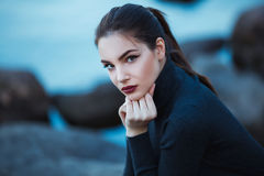 Beautiful young woman. Dramatic outdoor portrait of sensual brunette female with long hair. Sad and serious girl. Royalty Free Stock Photos