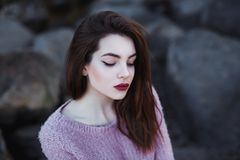 Beautiful young woman. Dramatic outdoor portrait of sensual brunette female with long hair. Sad and serious girl. Royalty Free Stock Image