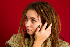 Beautiful young woman with dreadlocks Stock Images