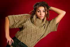 Beautiful young woman with dreadlocks on a red background Royalty Free Stock Photos
