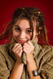 Beautiful young woman with dreadlocks on a red background Stock Photo