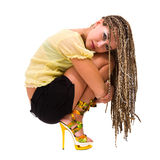 Beautiful young woman with dreadlocks siiting Stock Photography