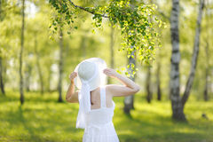 Beautiful young woman dreaming in a green Park. Beautiful young woman dreaming in a green Park Royalty Free Stock Photo