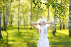 Beautiful young woman dreaming in a green Park. Beautiful young woman dreaming in a green Park Royalty Free Stock Image