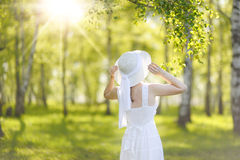 Beautiful young woman dreaming in a green Park. Beautiful young woman dreaming in a green Park Royalty Free Stock Photos