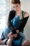 Beautiful young woman dreaming on window Stock Photo