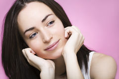 A beautiful young woman dreams smiling Royalty Free Stock Photography