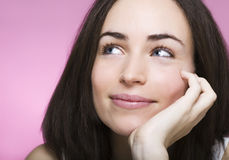 A beautiful young woman dreams smiling Royalty Free Stock Image