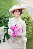 Beautiful young woman in dress and hat portrait in retro style. Vogue dressing in vintage Stock Images
