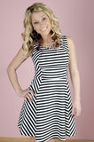 Smile. Beautiful young woman in a dress smiling Stock Photo