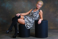Beautiful young woman in dress and stockings Royalty Free Stock Photo
