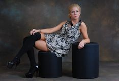 Beautiful young woman in dress and stockings Royalty Free Stock Image