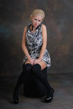 Beautiful young woman in dress and stockings Royalty Free Stock Photography