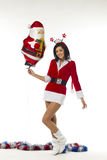 Beautiful young woman dressed as Santa Claus on a white backgrou Stock Photo