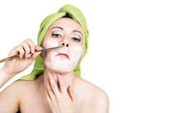 Beautiful Young woman dressed in a bath towel shaves with a straight razor. beauty industry and home skin care concept Stock Photos