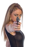 Beautiful young woman dressed in black with hand gun isolated on white Stock Photography