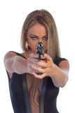 Beautiful young woman dressed in black with hand gun isolated on white Royalty Free Stock Photography