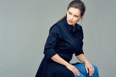 Beautiful young woman dressed in black shirt dress. Gray back isolated Royalty Free Stock Images