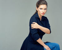 Beautiful young woman dressed in black shirt dress. Gray back isolated Stock Photos