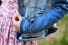 Beautiful young woman dressed denim jacket and dress. Beautiful young woman dressed denim jacket and pink dress Royalty Free Stock Photography