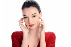 Beautiful young woman dressed in red with sexy red lips. Royalty Free Stock Photo
