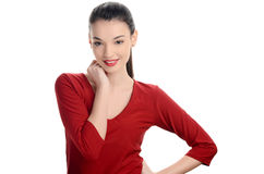 Beautiful young woman dressed in red with sexy red lips smiling. Royalty Free Stock Images