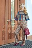 Woman standing at the door. Stock Photography