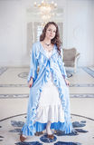 Beautiful young woman in dressing gown with frill Stock Photography