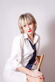 Beautiful young woman dressing in men's clothing Stock Image