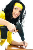 Beautiful young woman with a drill Royalty Free Stock Photo