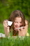 Beautiful young woman drink hot tea outdoor Stock Images