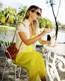 Beautiful young woman with a drink Piňa Colada Royalty Free Stock Photography