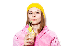 Beautiful young woman drinking alcoholic cocktail Stock Image