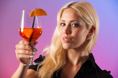 Beautiful young woman drinking aperol spritz Stock Photography