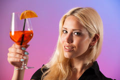 Beautiful young woman drinking aperol spritz Royalty Free Stock Images