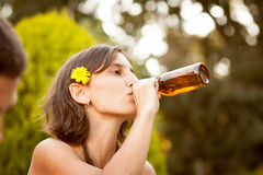 Beautiful young woman drinking beer stock photography