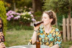 Beautiful young woman drinking beer Stock Photo