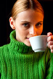 Beautiful young woman drinking cappuccino Stock Photos