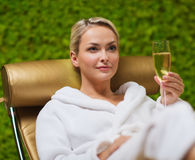 Beautiful young woman drinking champagne at spa Royalty Free Stock Image
