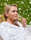 Beautiful young woman drinking champagne at spa Stock Image