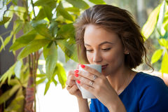 Beautiful Young Woman Drinking Coffe In A Coffee Shop Stock Photos