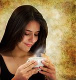 Beautiful young woman drinking coffee Royalty Free Stock Photos