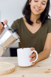 Beautiful young woman drinking coffee at home. Royalty Free Stock Photography