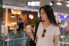 Beautiful young woman drinking coffee.For the hustle and bustleof of traveling stock photos