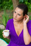 Beautiful young woman drinking coffee Stock Photography