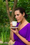Beautiful young woman drinking coffee Royalty Free Stock Photography