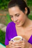 Beautiful young woman drinking coffee outdoors Stock Photos