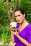 Beautiful young woman drinking coffee outdoors Royalty Free Stock Photos