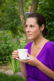 Beautiful young woman drinking coffee outdoors Stock Photography