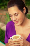 Beautiful young woman drinking coffee outdoors Royalty Free Stock Photo
